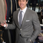 Andrew Mihalik in a slim fitting pinstripe grey suit