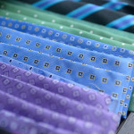 Flashy purple, blue and green ties